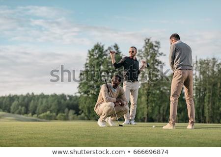Férfi játszik golf tengerpart sport tájkép Stock fotó © dagadu