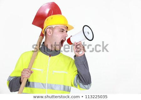 Worker with a spade screaming into a bullhorn Stock photo © photography33