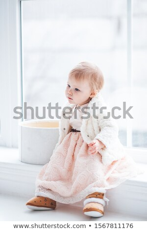 baby girl portrait dress in pink with winter white fur stock photo © lunamarina