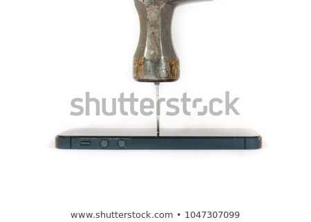 Close up of a hammer driving a nail against a white background Stock photo © wavebreak_media