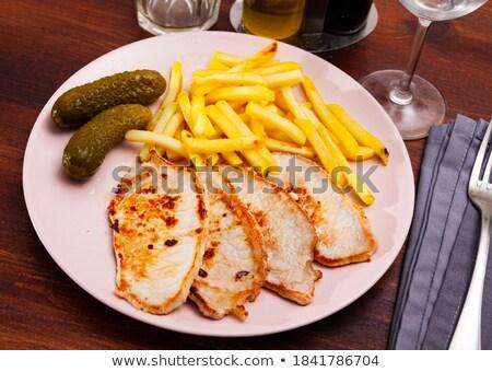 Pork fillet baked inside a potato chops Stock photo © neiromobile