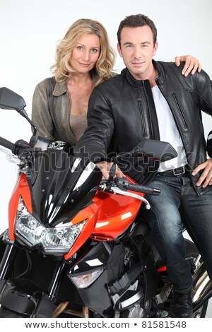 Biker chic leaning on biker's shoulder. Stock photo © photography33
