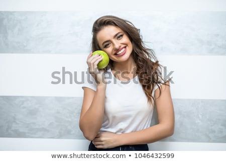 alegre · nina · cama · manzanas · lencería - foto stock © justinb