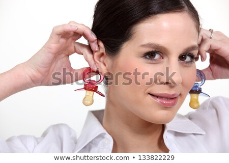 Woman with baby's dummies as earrings Stock photo © photography33