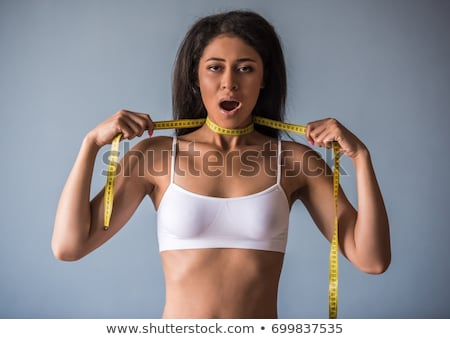 Woman strangling herself with measuring tape Stock photo © Kzenon