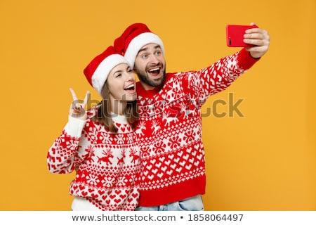 christmas · opgewonden · vrouw · tonen · overwinning · teken - stockfoto © ichiosea