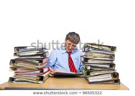 man studies folder with files at his desk in the office Stock photo © meinzahn