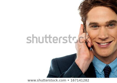 Smiling corporate guy attending phone call Stock photo © stockyimages