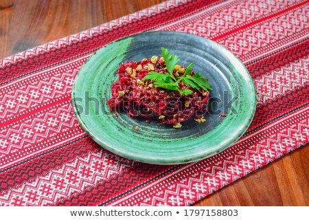 Stock photo: Chef slicing boiled beetroot