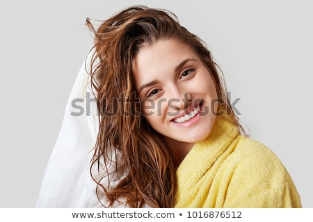 mosolygó · nő · áll · fehér · fürdőköpeny · modern · szoba - stock fotó © bmonteny