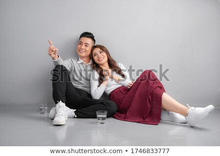 casual young man points at ground stock photo © feedough