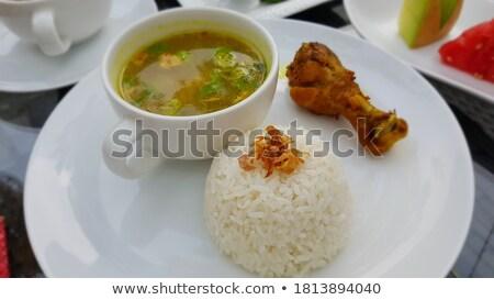 Indonesio arroz curry salsa servido papel Foto stock © dinozzaver
