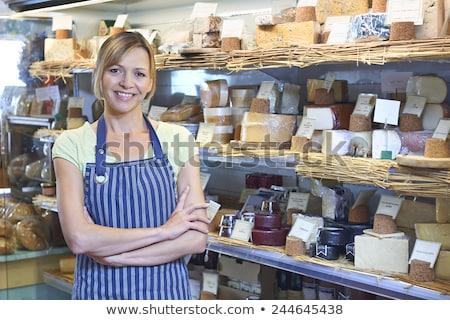 Proprietario piedi formaggio display business donna Foto d'archivio © HighwayStarz