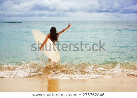 surfing girl happy excited going surfing at beach stock photo © maridav