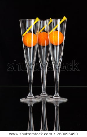 Three glasses of champagne and golf tees Stock photo © CaptureLight