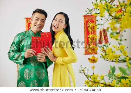 Happy Asian female showing an envelope Stock photo © szefei