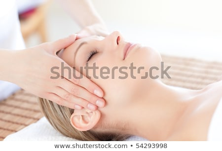 attractive woman receiving head massage at spa center stock photo © wavebreak_media