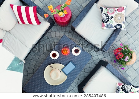 Relaxing on a brick patio by candlelight Stock photo © ozgur