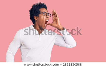 Bell'uomo urlando fuori forte bianco shirt Foto d'archivio © wavebreak_media
