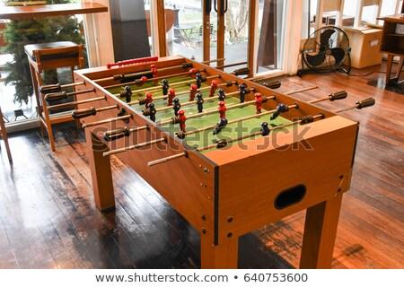 vintage foosball table soccer or football kicker game stock photo © stevanovicigor