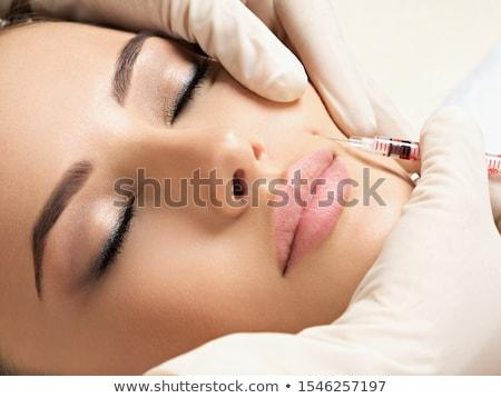 Vrouw cosmetische injectie botox jonge vrouw grijs Stockfoto © deandrobot