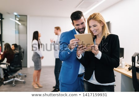 colleagues using digital tablet in office stock photo © wavebreak_media