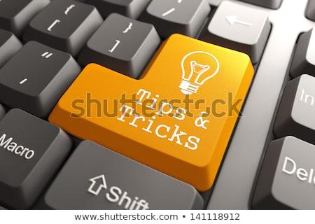 Сток-фото: Tips And Tricks - Concept On Orange Keyboard Button