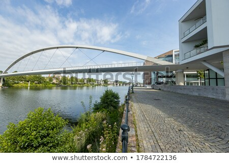 bridge over water with lamp pole stock photo © leungchopan