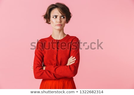 Cute offended girl standing with hands crossed  Stock photo © deandrobot