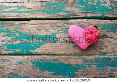 Red heart shape made from wool on old shabby wooden background stock photo © vlad_star
