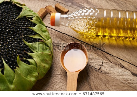 Stock photo: sunflower seed oil and vegetables for preparation of salad