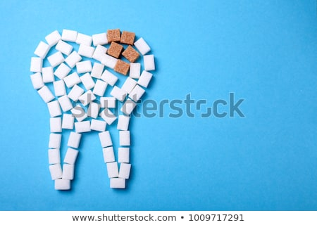 A tooth with candies Stock photo © bluering