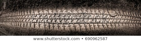 Abstract background - the wheel tracks in sand. Stock photo © traza