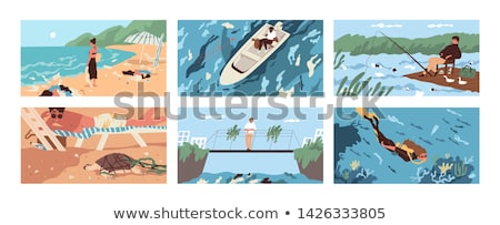 people on the beach and boats in the sea stock photo © bluering