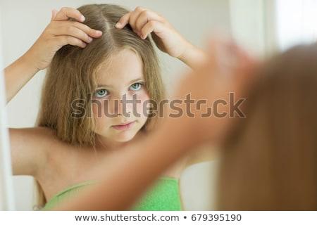 Girl having head lice Stock photo © bluering