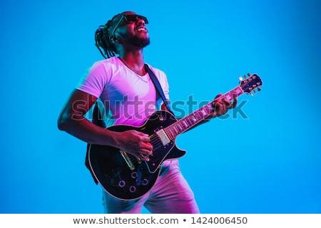 Genç moda gitarist oynama gitar caz Stok fotoğraf © gravityimaging