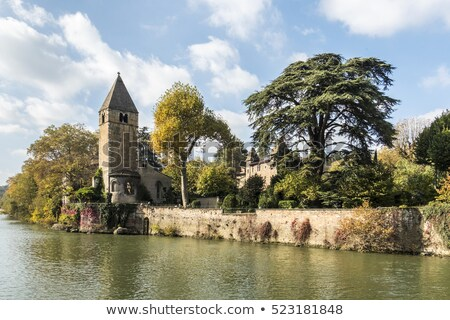 Monumental church tower on the island Ile Barbe in the Saone, in Stock photo © meinzahn