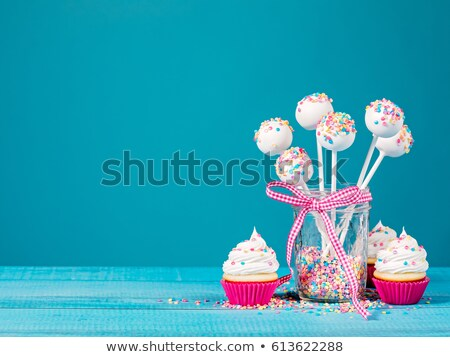 Stock photo: cake pops and cupcake
