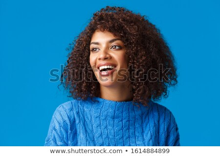 Carefree young woman in snowy ski resort Stock photo © dash