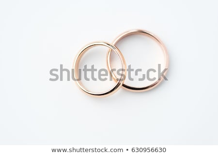 two golden wedding rings isolated on white wedding rings background concept stock photo © lightfieldstudios