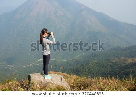 Menina em pé floresta binóculo criança Foto stock © wavebreak_media