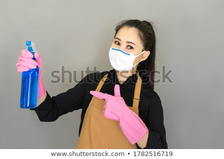 Fiatal nő törlés spray izolált rongy ablak Stock fotó © julenochek