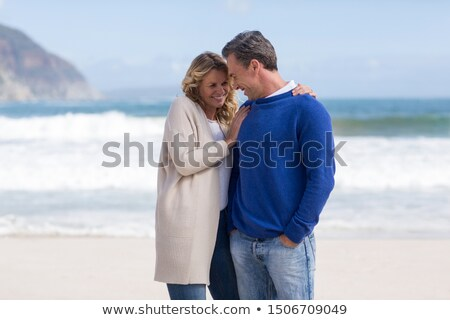 Mature couple standing close together Stock photo © IS2