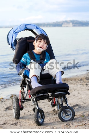 Cute disabled boy with cerebral palsy smiling in stroller Stock photo © jarenwicklund
