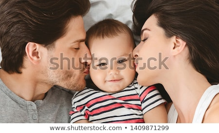 couple playing in bed with boy Stock photo © IS2