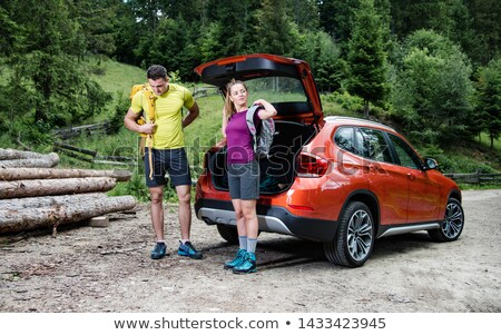 man and woman talking in car park Stock photo © IS2