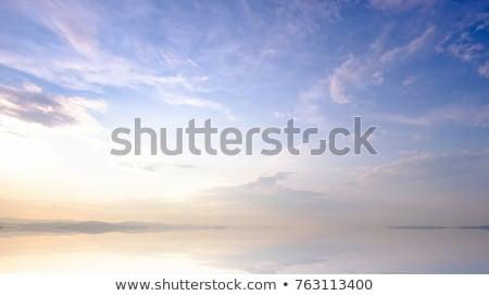 Plaj okyanus gündoğumu bulutlu gökyüzü akşam Stok fotoğraf © alinamd