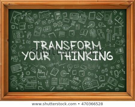 Green Chalkboard with Hand Drawn Transform Your Thinking. Stock photo © tashatuvango