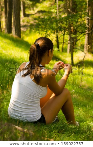 girl resting on leaves stock photo © is2