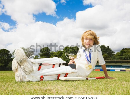 Boy Cricketer with medals and Trophy Stock photo © IS2